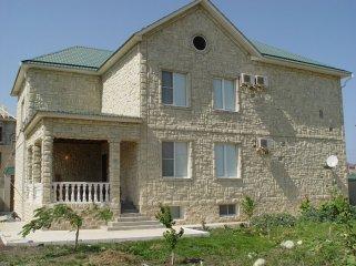 Облицовка дома искусственным фасадным камнем